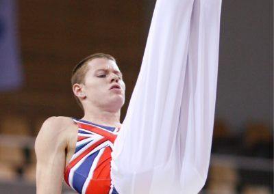 2006 World Championships Aarhus Oliver Kneen-Oliver-GBR on Parallel Bars